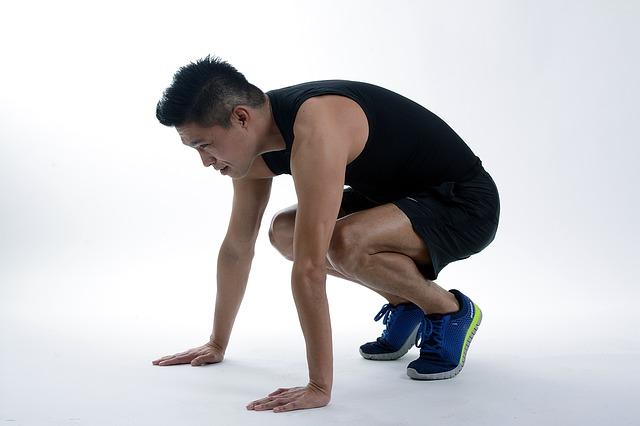 man-squatting