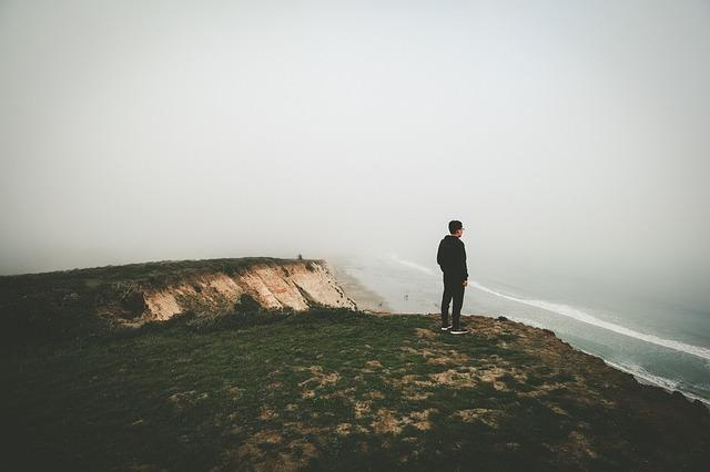 person alone on the side of a cliff